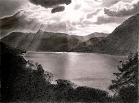 """Sunset over Buttermere"" - Following a heavy storm in the Lake District, the setting sun starts to break through the heavy clouds.<br/>Graphite - 10"" x 8"""